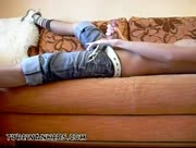 lad wanking lying on couch